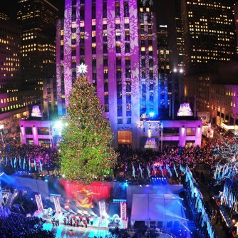The Rockefeller Center Christmas Tree is lit December 4, 2013 in New York. AFP PHOTO/Stan HONDA (Photo credit should read STAN HONDA/AFP/Getty Images)